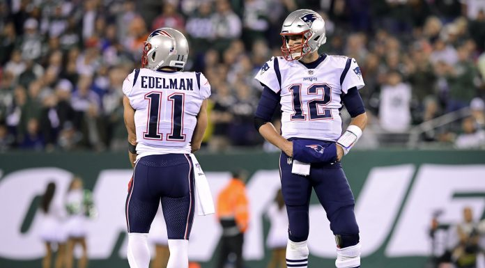 EAST RUTHERFORD, NEW JERSEY - OCTOBER 21: Julian Edelman #11 and Tom Brady #12 of the New England Patriots looks on against the New York Jets at MetLife Stadium on October 21, 2019 in East Rutherford, New Jersey. (Photo by Steven Ryan/Getty Images)